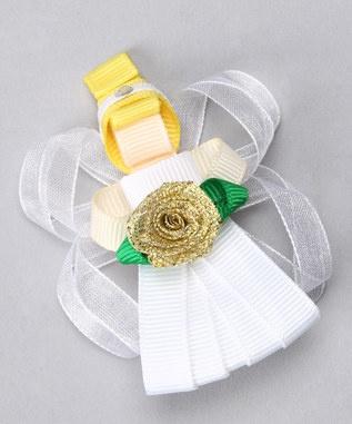 Angel hair bow of ribbons