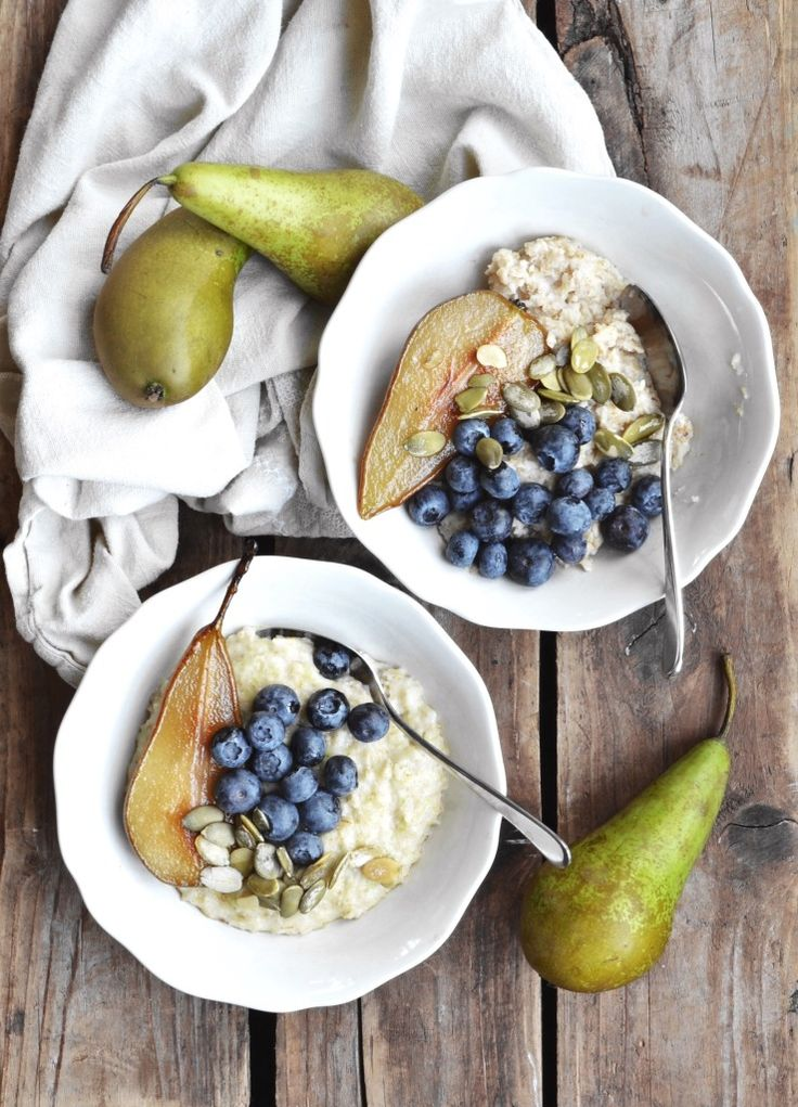 Zoatmeal (zucchini oatmeal) with maple caramelized pears, blueberries and pumpkin seeds. Vegan and gluten free.