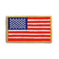 "Embroidered U.S. flag applique with 100% thread coverage. Adhesive back. Red, white and blue thread with yellow merrowed border. In stock for fast delivery.  Complies with ANSI, ASTM, CPSIA, Prop 65.  1 1/8"" L x 2"" W"