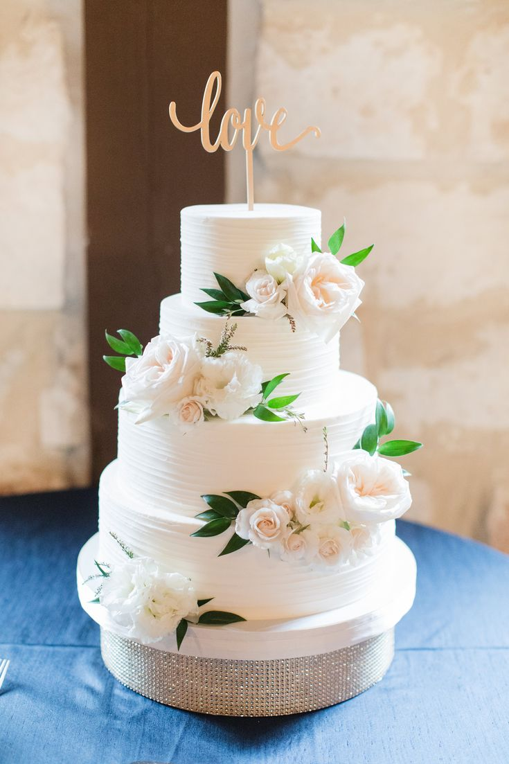 Such a gorgeous, bohemian wedding cake!  Love the simple white cake with blush flowers and the gold cake topper. Taken at THE SPRINGS in Rockwall, Poetry Hall.  Follow this pin to our website for more information, and to book your free tour! Photographer:  Michelle Rice Photography #bohowedding #weddingcake #bohoweddingcake #weddingcakeideas #bohemianwedding #bohemianweddingcake #bohemianweddingideas #blushweddingcake #elegantweddingcake #elegantwedding