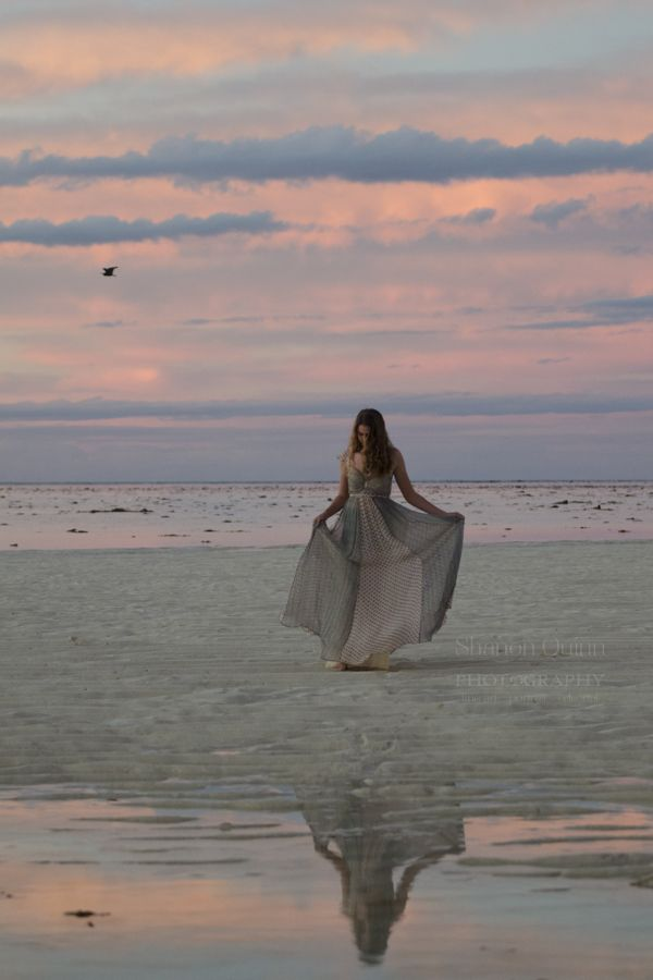 shanonquinnphotography.com Whimsy. Sunset Heron Island Great Barrier Reef. Girl on beach dancing.