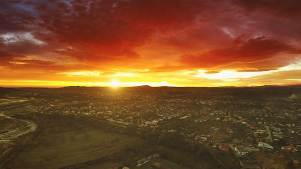 Surreal Sunset by studio_21 This is an aerial apocalyptic scenery of a sunset in late autumn over the mountain formations at the horizon in a city in a valley