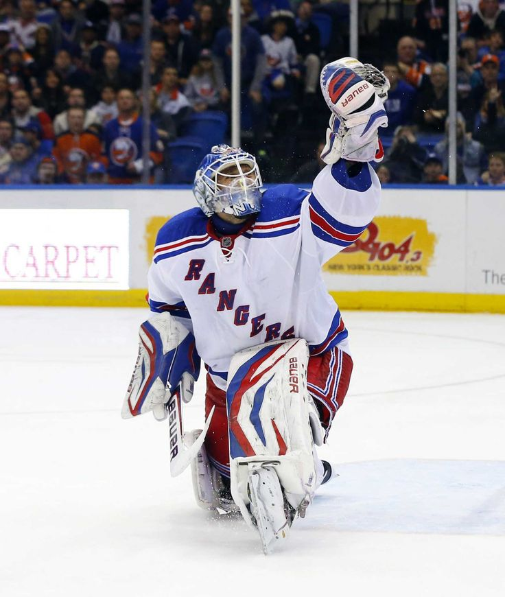 Henrik Lundqvist of the Rangers makes a glove save in the third period against the Islanders at Nassau Coliseum. (April 13, 2013)  Credit Jim McIsaac
