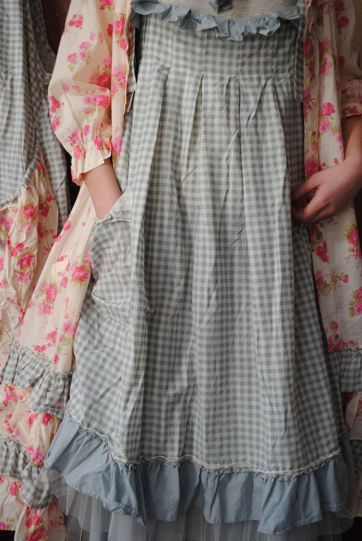 Pinafore style dress with apron overrobe. Interesting ruffles and pleating at neckline.
