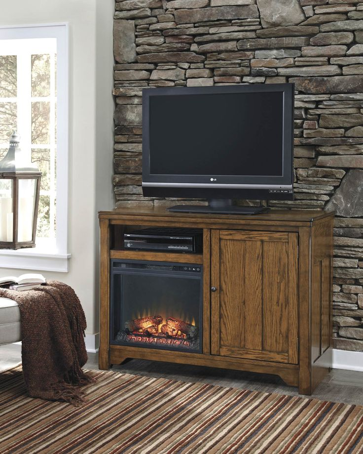 Medium TV Stand w  Fireplace Option   Ashley   Home Gallery Stores. 1000  images about TREND  Built in Fireplaces on Pinterest