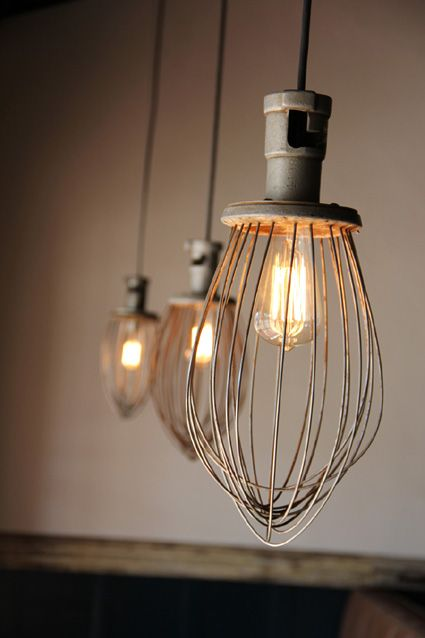 Lights made from whisks from a commercial kitchen mixer.- love the whimsy!