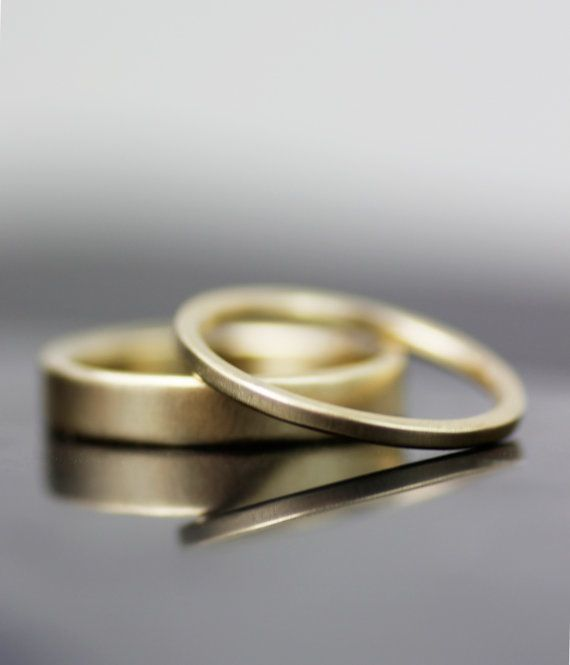 Simple super skinny wedding band set This listing is for the set of TWO flat bands. These rings can also be ordered separately. NOTE: All photos...