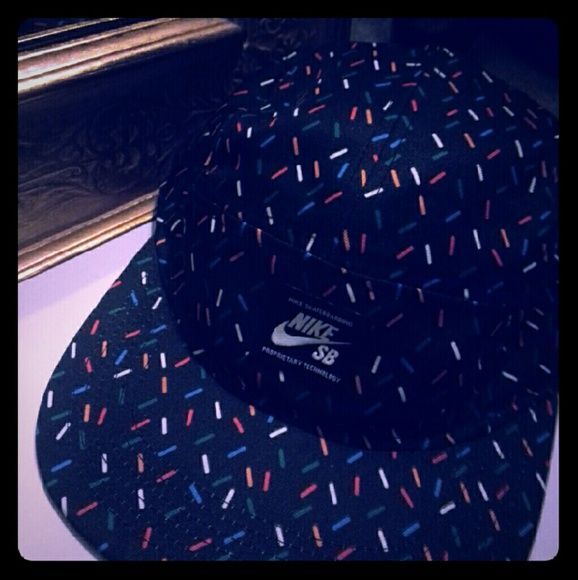 Nike skateboard hat Worn a couple  times and its like cupcake sprinkles. Clip back. Black hat with red/white/ green/orange sprinkles. Nike SB Nike Accessories Hats