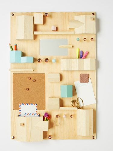 This hanging storage piece could hold just about everything on your home office desk so you'll have enough workspace.