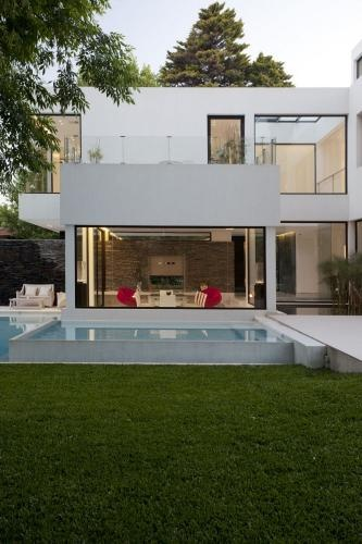 Houses with pool in Buenos Aires-I like this house because it reminds me of the beach houses in Santa Monica.
