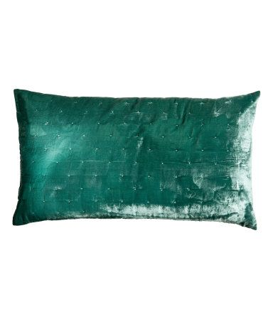 Emerald green. Cushion cover with lightly padded velvet at front and solid-color, woven cotton fabric at back. Concealed zip.