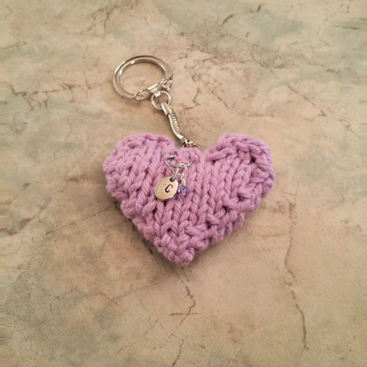 June Lt Amethyst Birthstone Handstamped Initial Charm Knit Heart Keychain. June Lt Amethyst Birthstone/Month handstamped Initial Charm Tiny Hand Wirewrapped Birthstone Dangle Cotton Knit Heart Keychain. Choose your Initial in the drop-down menu. Hand stamped and knit by me, only 3 of each month available. Measurements: Knit Heart: 2 1/2in at widest part Initial Charm: 10mm Birthstone Charm: 2mm.
