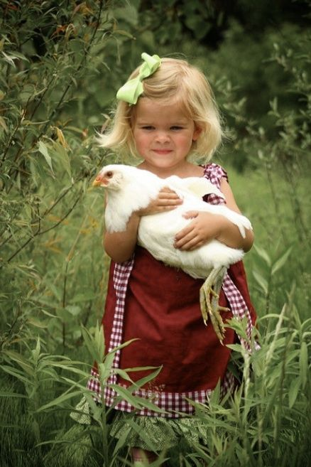 Little girl and her hen.