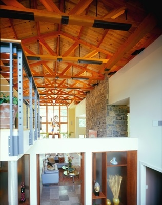 Very modern use of timbers adn steel in this timber truss project ...