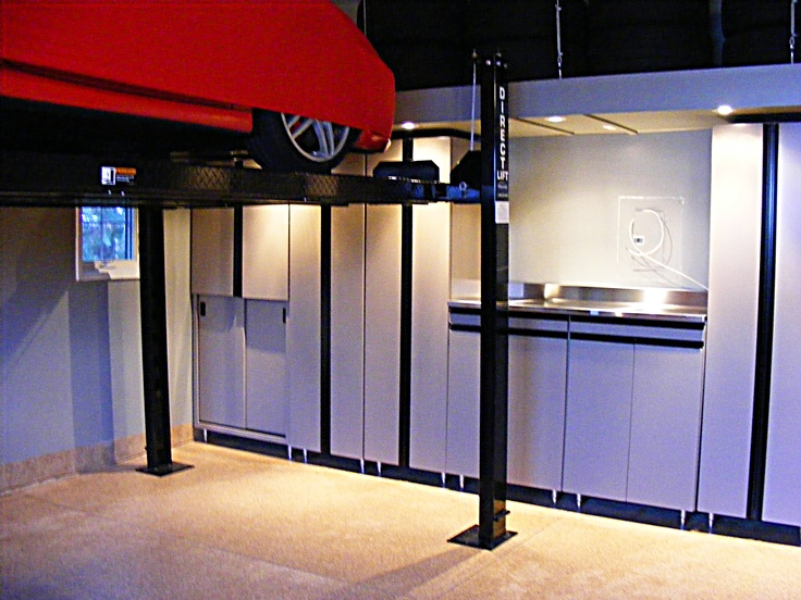 What a show piece auto car lift garage cabinets for Garage piece auto