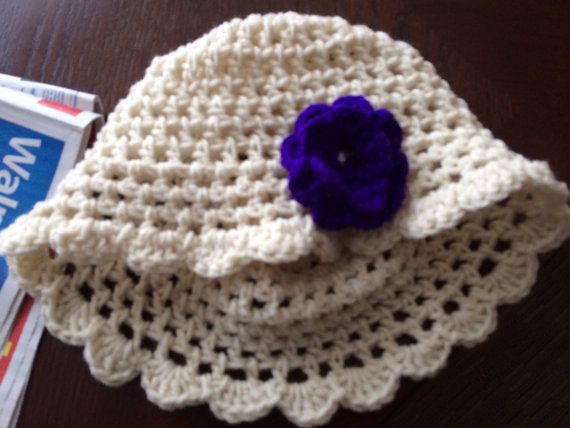 Crochet hat with flower made to order on Etsy, $15.00 CAD