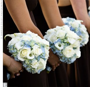 Pale blue hydrangeas with white roses and mini calla lilies