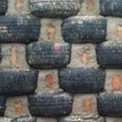 Dan Clark Furniture & Joinery | Tyre building with living roof handbuilt in Sussex
