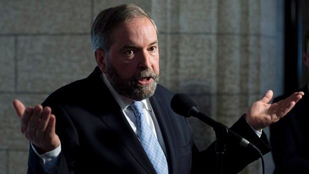 NDP Leader Tom Mulcair says the oilsands boom boosted the loonie and undermined manufacturing. 'It's by definition, Dutch disease.'