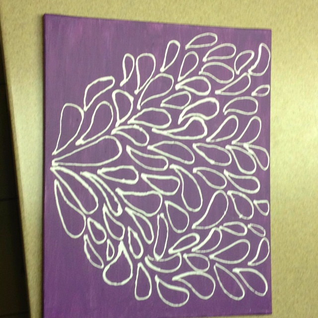 Elmer's glue on canvas and then painted the whole thing ...