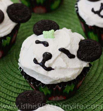 Panda cupcakes -- super cute especially with squinty gel frosting eyes. | isthisREALLYmylife.com #cupcakes #recipe #panda #birthday