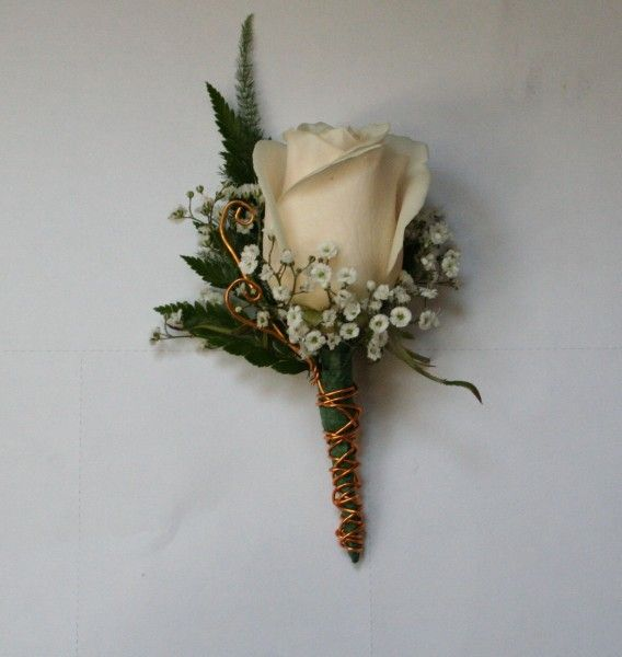 The men will wear white rose boutonnieres with baby's breath, plumosa, and lemon leaves wrapped in black satin ribbon