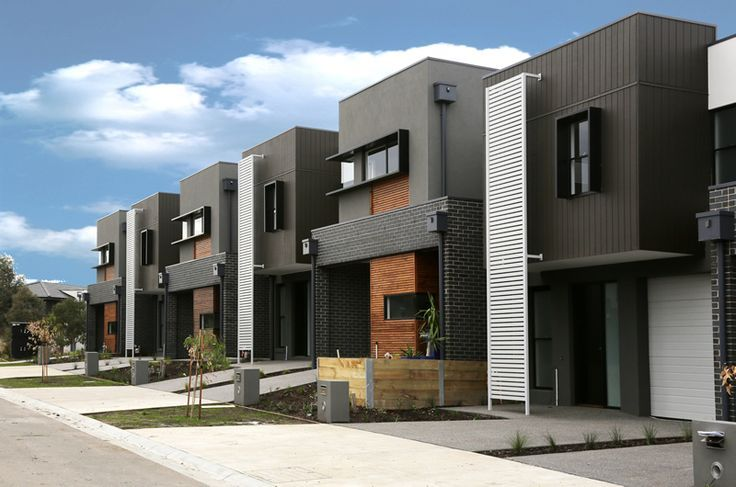 Modern Townhouse Exterior - Clean lines, nice use of brick, wood and siding