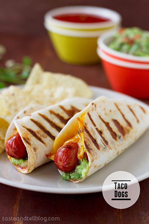 Taco Dogs! Hot dogs go Mexican with salsa, guacamole, and cheese in a tortilla.
