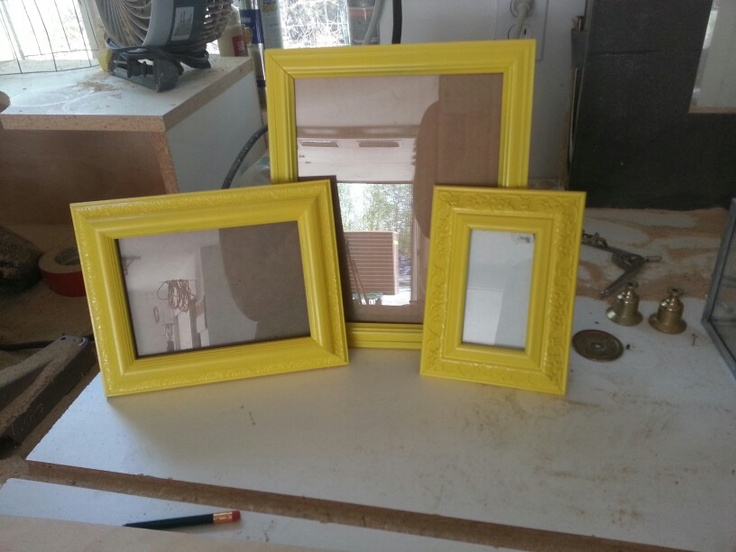 Old picture frames painted bright yellow.