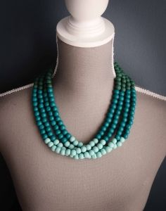 This Green and Blue Ombre Necklace is a multi strand wooden necklace in shades of greens and blues – more specifically green, teal and aqua.  Shop @ www.wave2africa.com