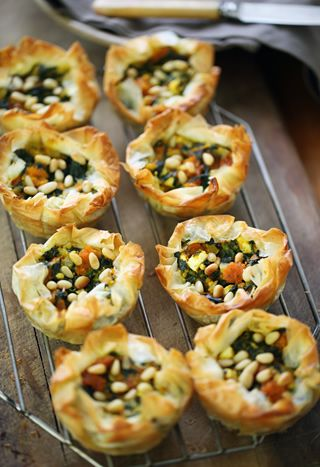 Filo tartlets with spinach, pumpkin, feta & pine nuts