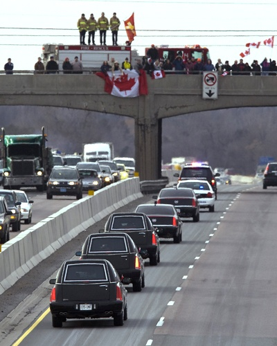 Fallen Canadian Soldiers Come Home. When a fallen soldier is repatriated onto Canadian soil the precession travels from Trenton Ontario to Toronto Ontario along a stretch of HWY 401 that has been re-named Highway of Heroes. Supporters gather on overpasses, on-ramps, and along the side of the highway to salute, applaud, stand silent, or otherwise show their support.