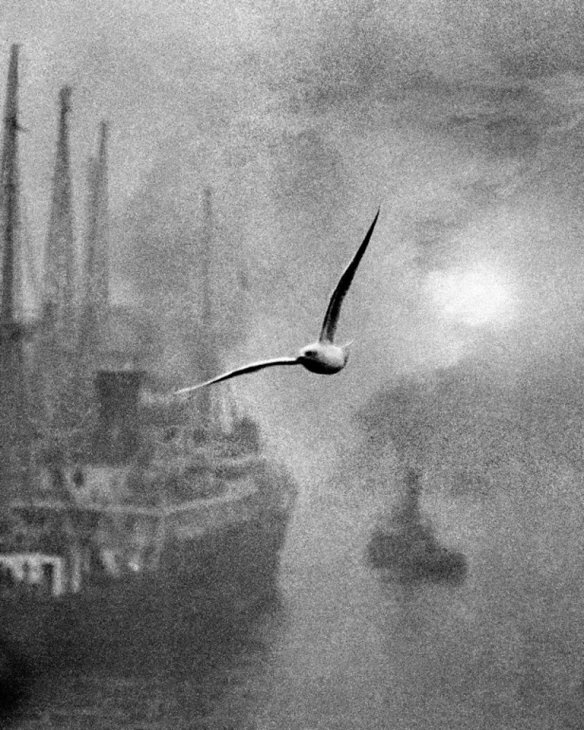 photographer: Bill Brandt, 1935. This is actually two shots superimposed due to the low light levels. Atmospheric shot, similar to Turner's art