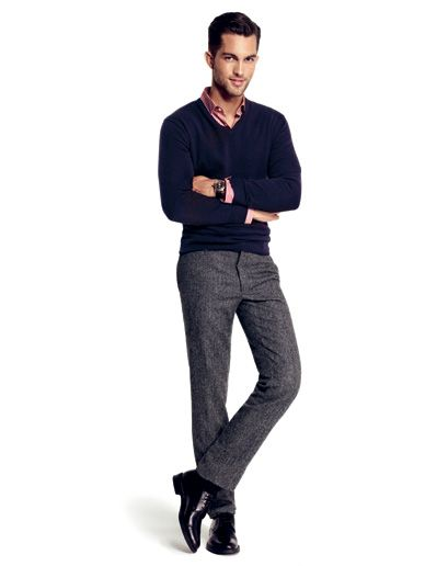 Gray wool pants with red collared shirt and blue v-neck sweater