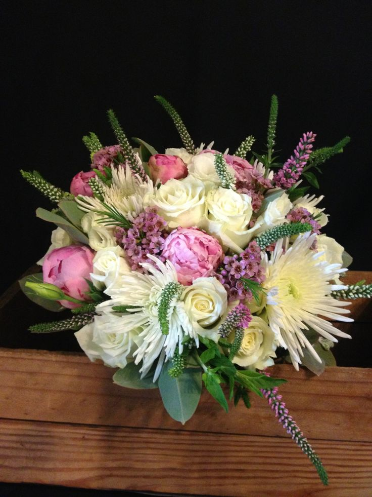 brides bouquet with roses ,peony roses,veronica,disbud chrysanthemum & erisostemon with gum nuts