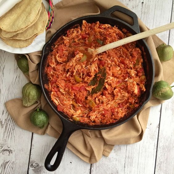Tinga de pollo is a Mexican dish with a tomato base and shredded chicken, chorizo, tomatillos, chipotle chiles and spices.