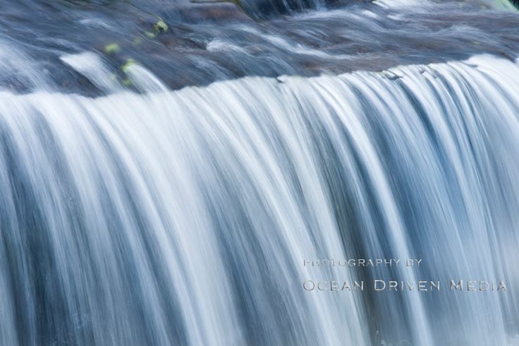 Water flowing over a weir, blurred from movement