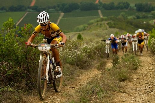Burry Stander powers up the infamous Groelandberg while other riders are reduced to pushing their bikes during the 2012 Cape Epic. (Sven Martin/Cape Epic/SPORTZPICS)