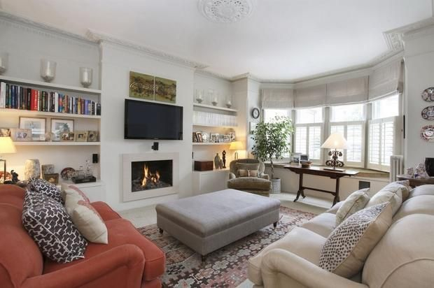 We love the use of mixed patterns and textures in this home. That fire makes us want to curl up and relax!
