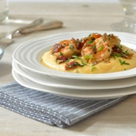 Shrimp and Cheese Grits (with bacon). Rich.  Completely decadent.  Pure comfort food.  You get the idea.