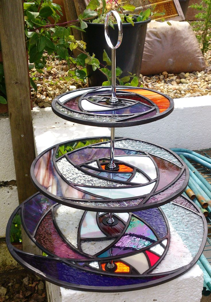 What a unique idea!!! Stained glass cup cake stand. I may have to make one of these!!