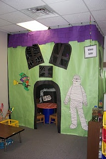 Use a shower curtain to hang and turn the reading corner into the spooky haunted house! Inside: read books with witch fingers or bones, guess how many slimy eyeballs are in the jar, make a skeleton puzzle, dress up in different Halloween costumes