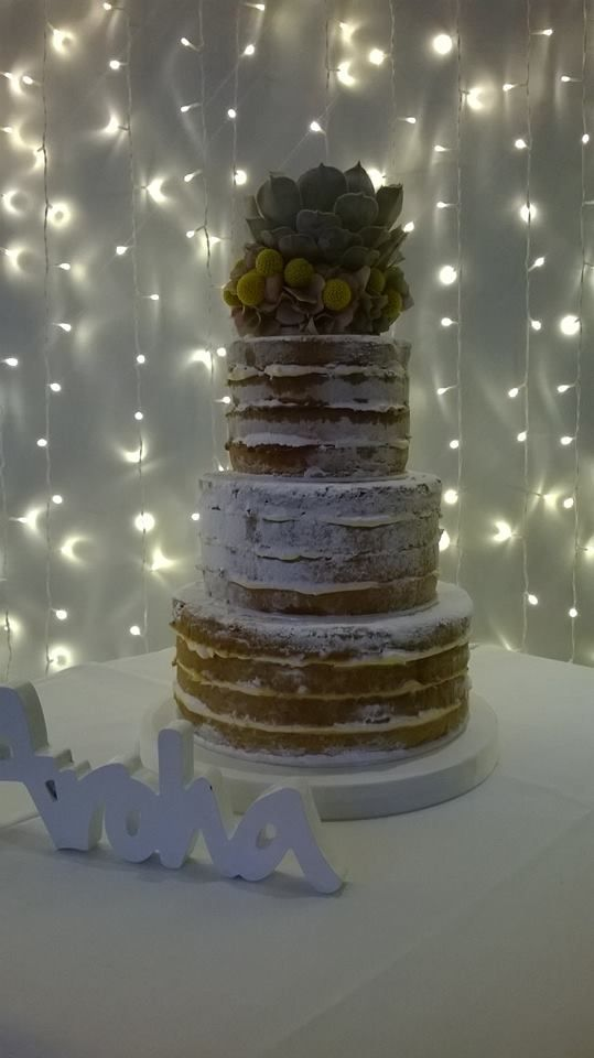 """Naked wedding cakes are bang on trend this season! Do you like them?  This one consists of:  6"""" Round classic vanilla sponge layered with four layers of sponge with strawberry jam and vanilla butter cream 8"""" Round coconut sponge layered with four layers of sponge with Malibu butter cream 10"""" Round lemon drizzle sponge layered with four layers of sponge with lemon curd and lemon buttercream  #nakedcake #weddingcake #vanilla #sponge #buttercream   #strawberry #coconut #malibu #lemondrizzle"""