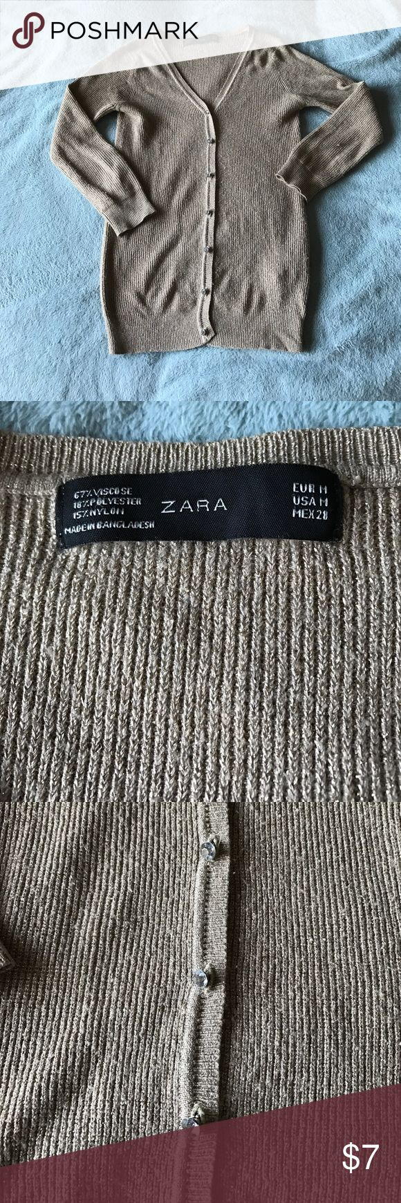 Zara Gold Cardigan Zara gold cardigan. Label says M. However I think it fits more snug like a small. Gold and shimmery. Used, but still super fun and flirty! Zara Sweaters Cardigans