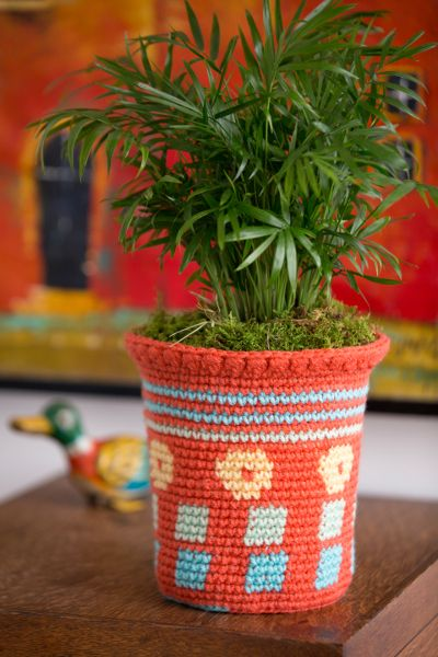 Floral Crush Flower Pot Cozy - Add some charm to your household plants with this simple yet striking pattern. Just place this crocheted cozy over a container and instantly add a splash of color to your surroundings. Designed by Nirmal Kaur Khalsa. From I Like Crochet's April 2014 issue