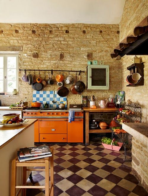 rustic kitchen with orange lacanche stove | interior design + decorating ideas