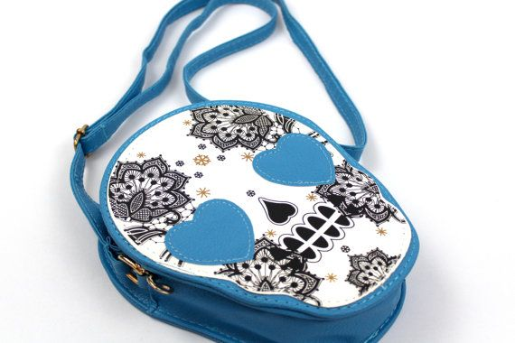 Get your Goth on with our super sweet handcrafted sugar skull bag in Cyan Blue, perfect to complete a pretty yet edgy look!   In stock ~ £20.00
