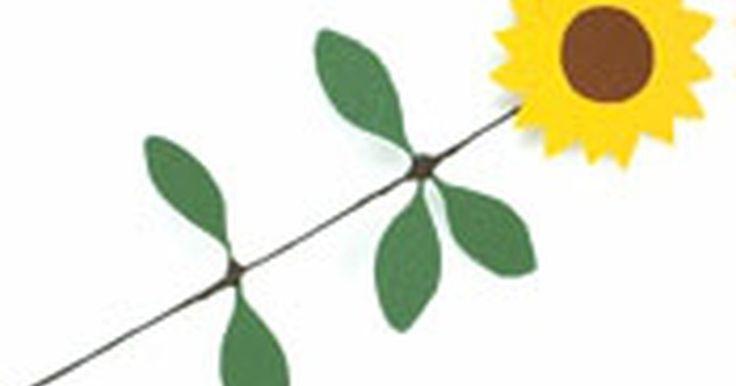 Como fazer girassóis de papel . Fazer uma ou mais dessas flores lindas e amarelas trará um ar de alegria durante a primavera e o verão para dentro de sua casa!
