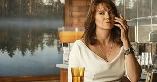 Candace Fawley - Lucy Lawless - 50 - bar owner and Counselor