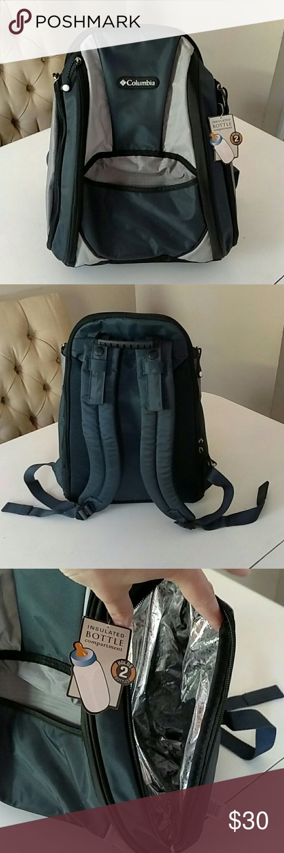 Columbia Trekster Backpack Diaper Bag In New condition, with some tags on it. Navy blue, silver, and black in color. Many compartments. Insulated bottle compartment. Changing pad. Rubber handle. Columbia Bags Baby Bags